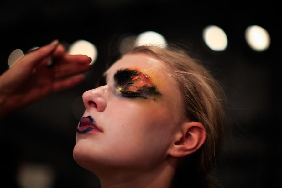 A model prepares for the display of Austrian designer Rebekka Ruetz during the Mercedes-Benz Fashion Week Berlin Autumn/Winter 2015 in Berlin,Germany on Jan. 20, 2015. (Xinhua/Zhang Fan)