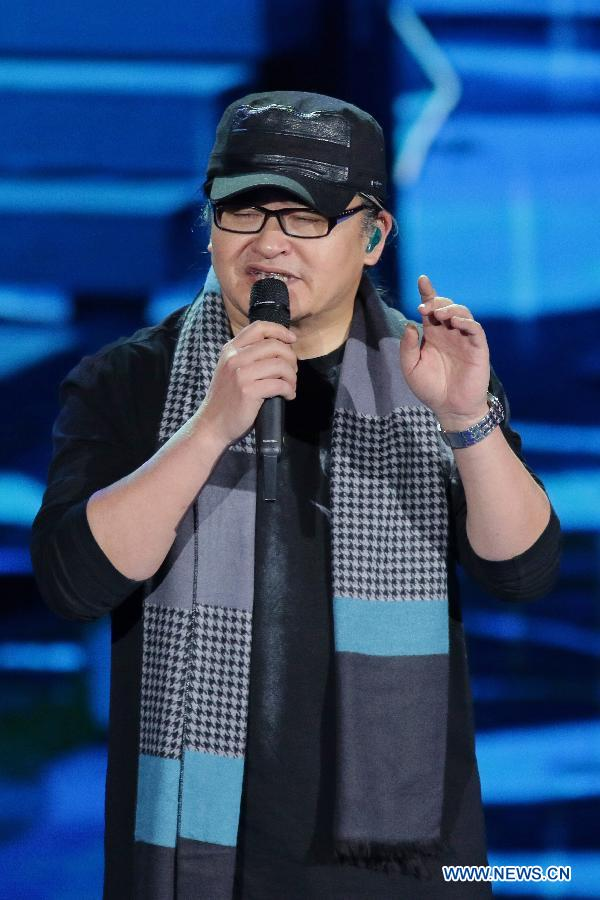 File photo shows singer Liu Huan performing during a rehearsal of the 2015 Spring Festival gala in Beijing, capital of China.