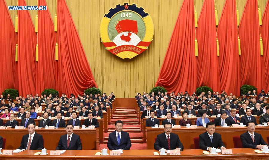 Xi Jinping (3rd L, front), Li Keqiang (3rd R, front), Zhang Dejiang (2nd L, front), Liu Yunshan (2nd R, front), Wang Qishan (1st L,front) and Zhang Gaoli (1st R, front) attend the opening meeting of the third session of the 12th National Committee of the Chinese People's Political Consultative Conference (CPPCC) at the Great Hall of the People in Beijing, capital of China, March 3, 2015.