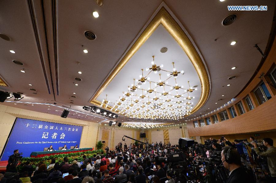 Xu Shaoshi, head of China's National Development and Reform Commission, gives a press conference for the third session of China's 12th National People's Congress (NPC) on the economic situation and macro-economic control in Beijing, capital of China, March 5, 2015. The third session of China's 12th NPC opened in Beijing on March 5. (Xinhua/Li Xin)