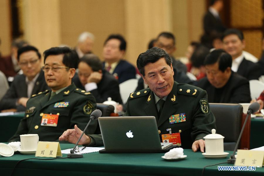 Liu Xing, a member of the 12th National Committee of the Chinese People's Political Consultative Conference (CPPCC), explains his idea of promoting cultural development during a panel discussion for the third session of the 12th CPPCC National Committee in Beijing, capital of China,March 7, 2015. (Xinhua/Ma Zhancheng)