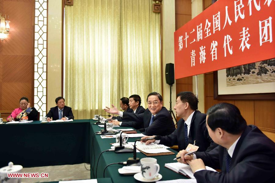 Yu Zhengsheng (3rd R), chairman of the National Committee of the Chinese People's Political Consultative Conference (CPPCC) and a member of the Standing Committee of the Political Bureau of the Communist Party of China (CPC) Central Committee, joins a discussion with deputies to the 12th National People's Congress (NPC) from northwest China's Qinghai Province during the third session of the 12th NPC, in Beijing, capital of China, March 8, 2015.