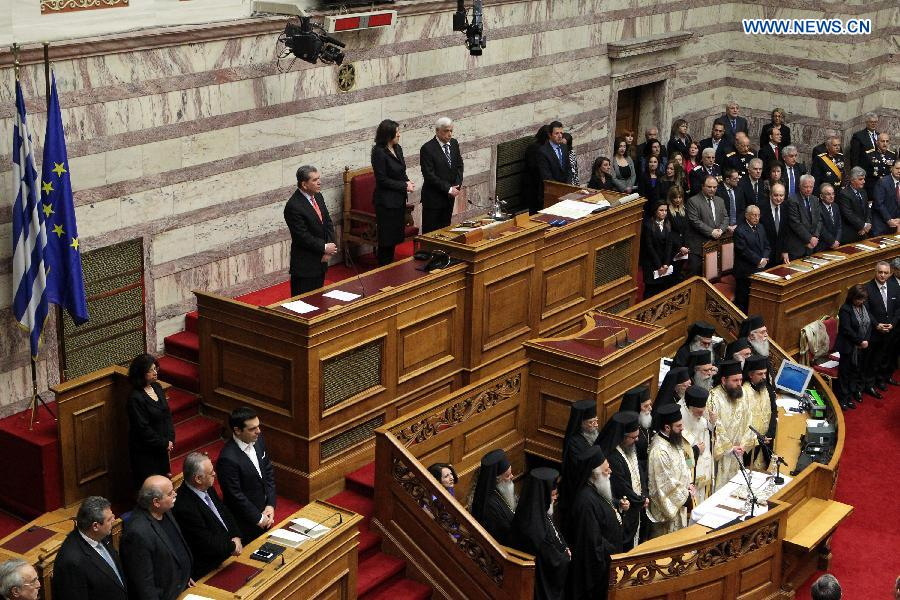 Newly elected Greek President Prokopis Pavlopoulos waits to take the oath during a swearing-in ceremony inside the parliament in Athens, Greek, on March 13, 2015.