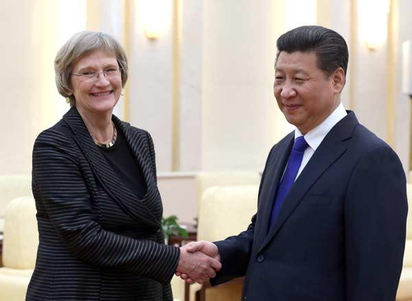 Xi greets president of Harvard