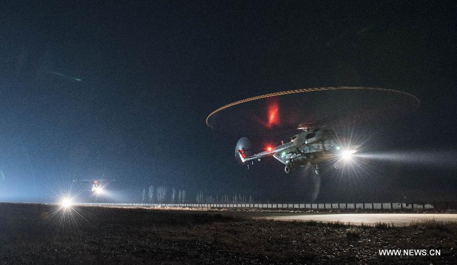 An army aviation brigade under the Xinjiang Military area command of the Chinese People's Liberation Army (PLA) conducted a day-night drill under actual combat conditions on Monday.