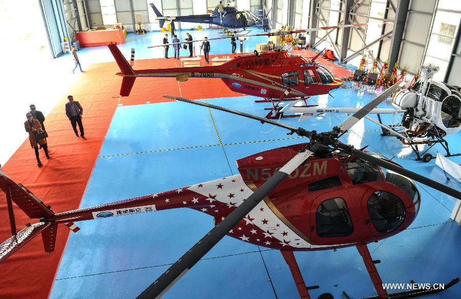 Helicopters for sale are seen at a helicopter store in Ningbo, east China's Zhejiang Province, April 8, 2015. The helicopter store was open on Wednesday. (Xinhua)