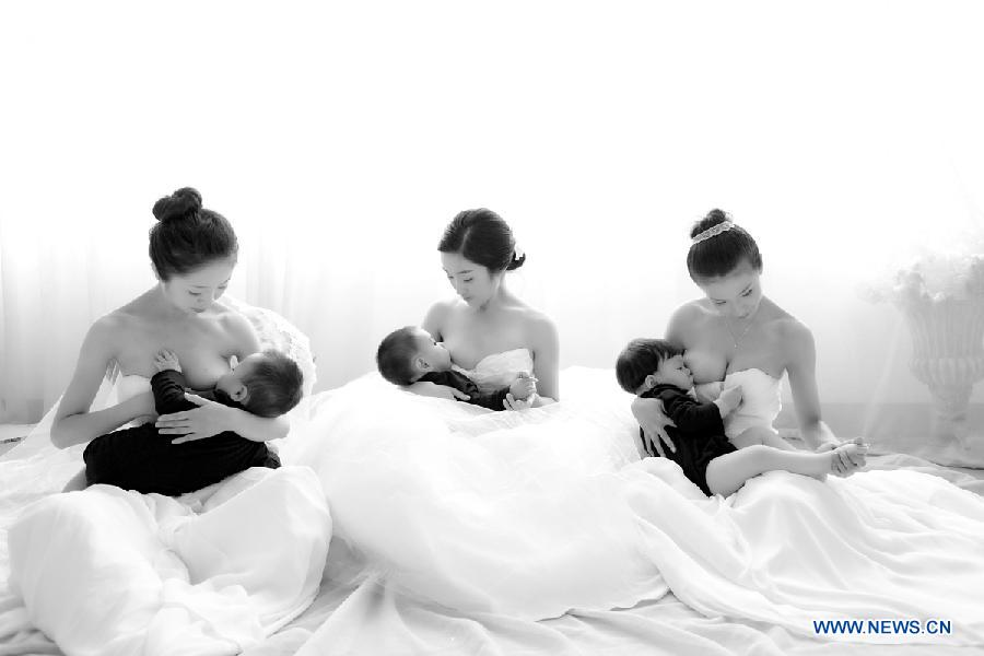 Photo provided by La Leche League-China shows mothers breastfeeding their children. May 20 is China's National Breastfeeding Awareness Day. As the pronounciation of '520' is close to 'I Love You,' many mothers feel meaningful to have their breastfeeding photos to make public. La Leche League-China, a branch of an international organization that provides mother-to-mother support, information and encouragment for breastfeeding, has collected art photos of breastfeeding mothers for three consecutive years. (Xinhua/La Leche League-China)
