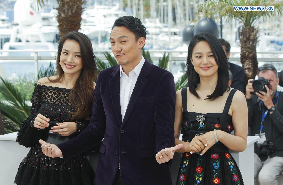Cast members Shu Qi (L), Chang Chen (C) and Zhou Yun of the film 'Nie Yinniang' (the Assassin) pose for photos at the photocall during the 68th Cannes Film Festival in Cannes, France, on May 21, 2015. The film 'Nie Yinniang' (the Assassin) would premiere at the 68th Cannes Film Festival on Thursday.