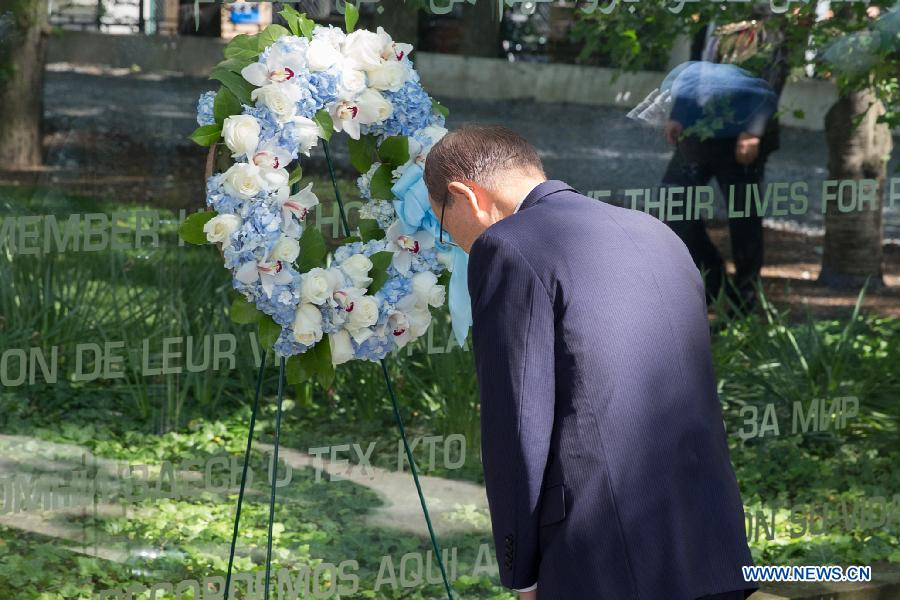 UN Secretary-General Ban Ki-moon pays tribute to peacekeepers who died in UN peacekeeping operations worldwide during a wreath-laying ceremony on the occasion of the International Day of United Nations Peacekeepers, at the United Nations headquarters in New York, United States, May 29, 2015.