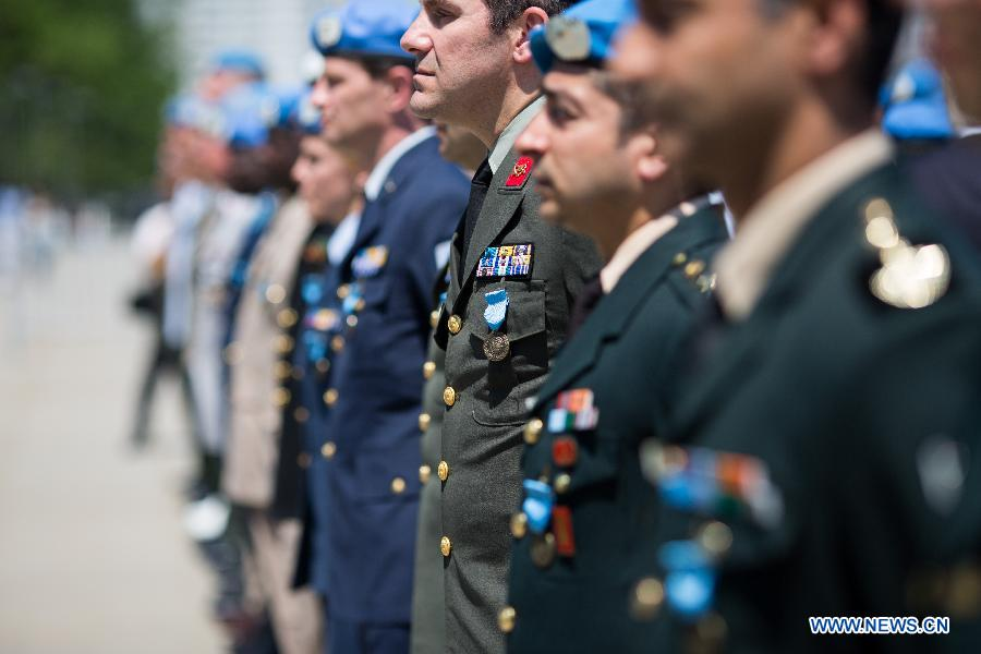 44 military and police personnel from 25 countries are awarded UN medals for their contributions to UN peacekeeping operations during service medal ceremony at the UN headquarters in New York, United States, May 29, 2015.