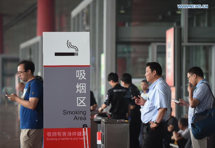 A new smoking ban took effect in Beijing on June 1. The new ban, the country's toughest to date, prohibits smoking in all the city's indoor public places, workplaces, and on public transportation. Following the ban, the capital's airport on Monday closed three smoking rooms in its three terminals and opened 11 smoking spaces outside.