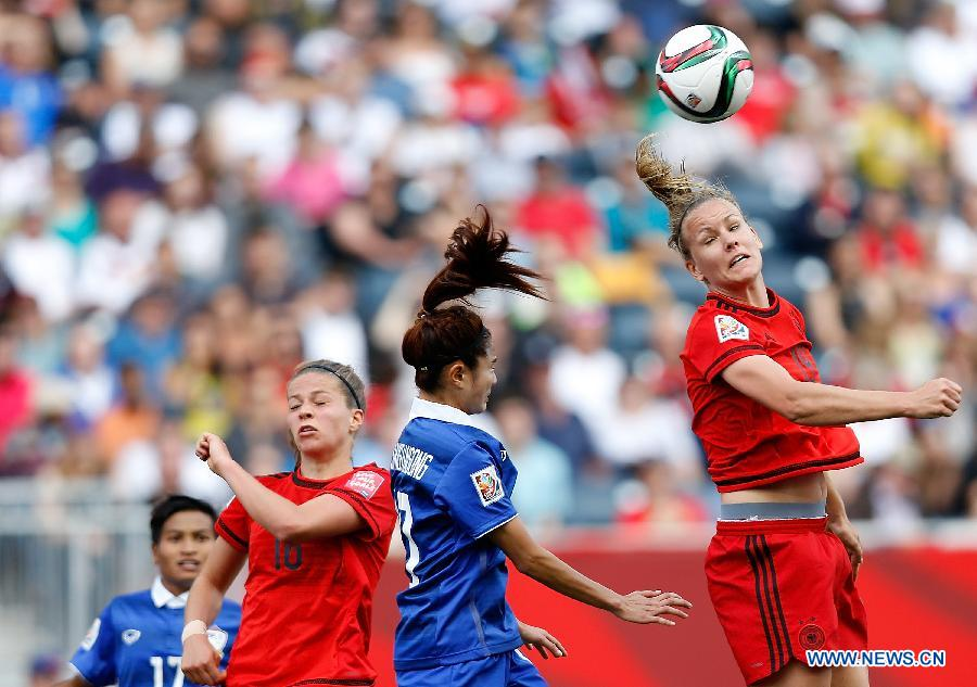 Lena Lotzen of Germany vies with Sunisa Srangthaisong of Thailand during the Group B match between Germany and Thailand at Winnipeg Stadium in Winnipeg, Canada on June 15, 2015.