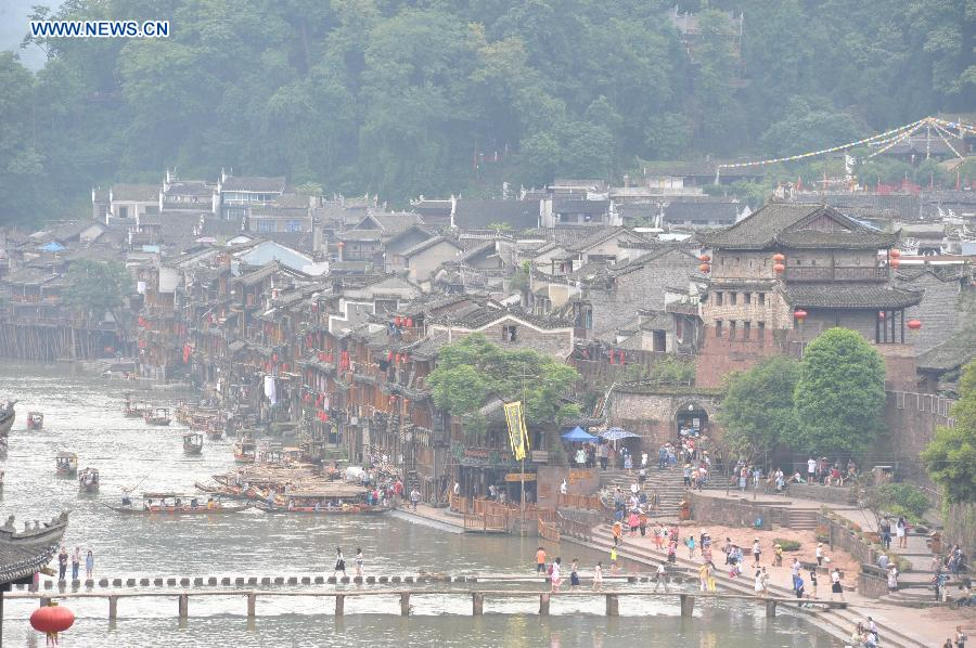 Photo taken on June 17, 2015 shows the ancient town of Fenghuang shrouded in fog in central China's Hunan Province.