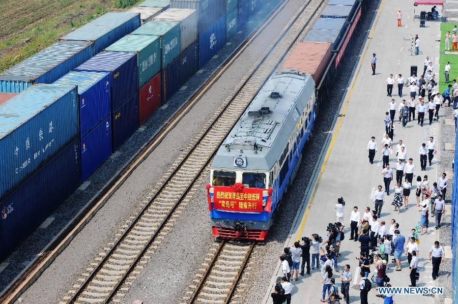 The 'Qingdao' freight train heading to Central Asia sets off from the central station of CRIntermodal in Qingdao, a port city in east China's Shandong Province, July 1, 2015.