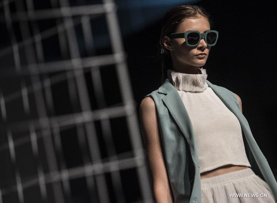 A model displays the creation at the Hong Kong Fashion Week for Spring/Summer in Hong Kong, south China, July 6, 2015.