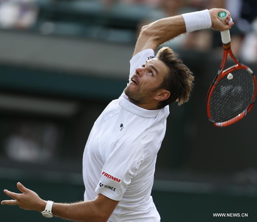 Stan Wawrinka of Switzerland servess a ball during men's quarterfinal match against Richard Gasquet of France at the 2015 Wimbledon Championships in Wimbledon, southwest London, July 8, 2015. Gasquet won the game 6-4, 4-6, 3-6, 6-4 and 11-9. (Xinhua/Ye Pingfan)