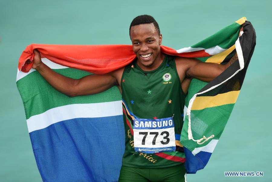 Akani Simbine of South Africa celebrates after winning Men's 100m Final at the 28th Summer Universiade in Gwangju, South Korea, on July 9, 2015.