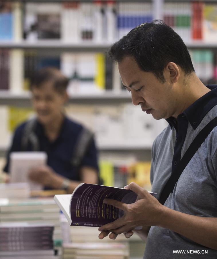 Citizens read books at the Hong Kong Book Fair in Hong Kong Convention and Exhibition Center in Hong Kong, south China, July 15, 2015.