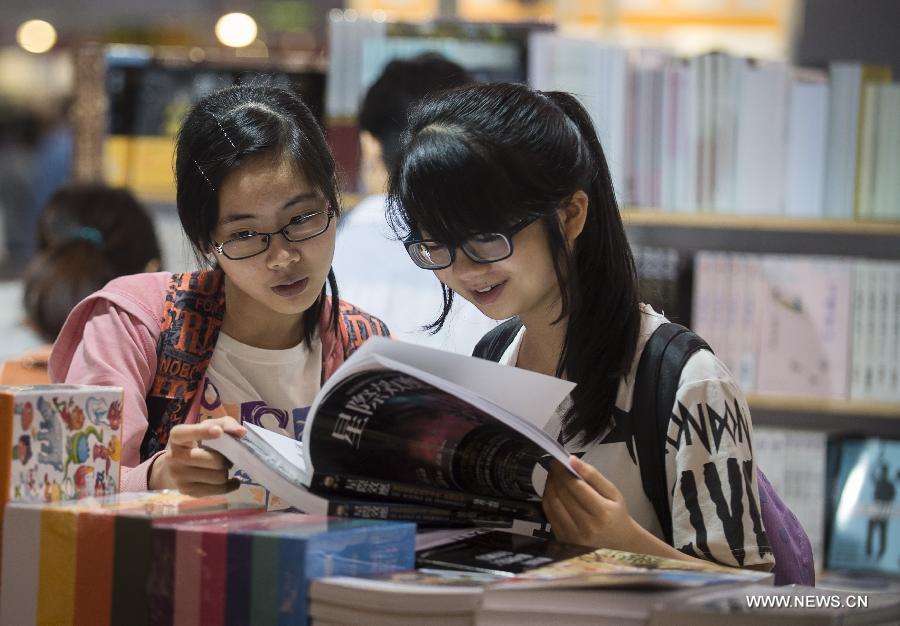 Citizens read books at the Hong Kong Book Fair in Hong Kong Convention and Exhibition Center in Hong Kong, south China, July 15, 2015.
