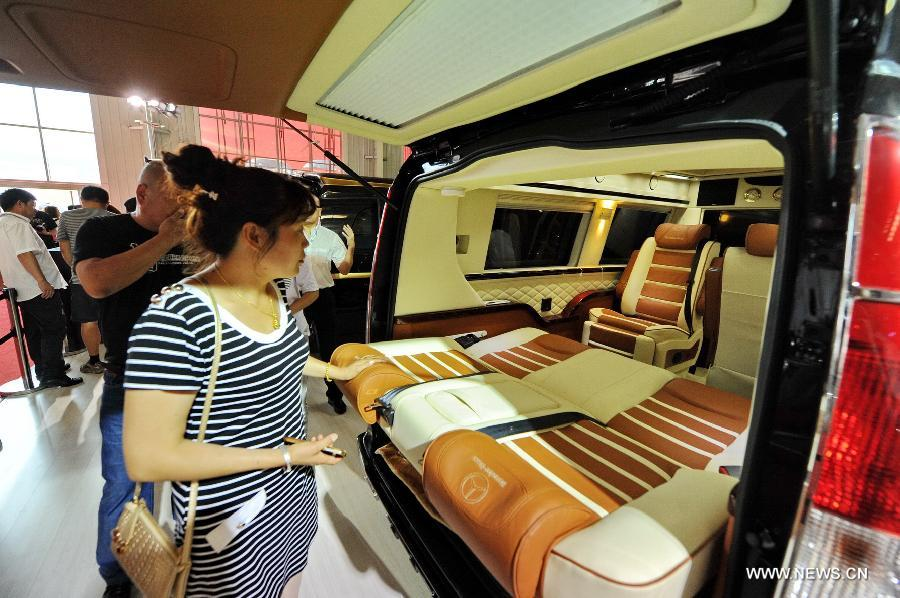The interior of a recreational vehicle attracts visitors at the 12th China Changchun International Automobile Expo in Changchun, northeast China's Jilin Province, July 15, 2015.