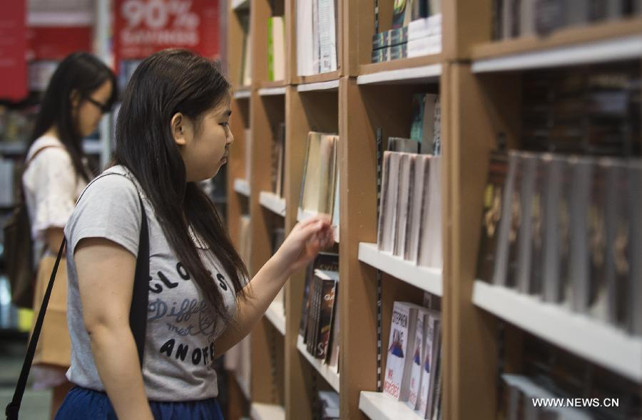 Citizens choose books at the Hong Kong Book Fair in Hong Kong Convention and Exhibition Center in Hong Kong, south China, July 15, 2015.