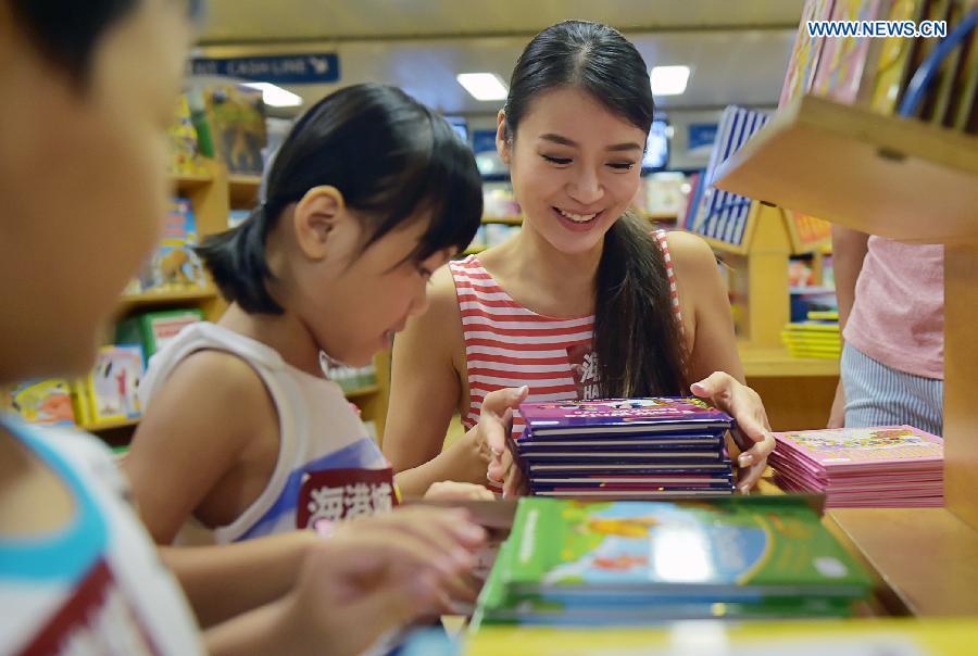 Visitors select books at Logos Hope in south China's Hong Kong, July 27, 2015.