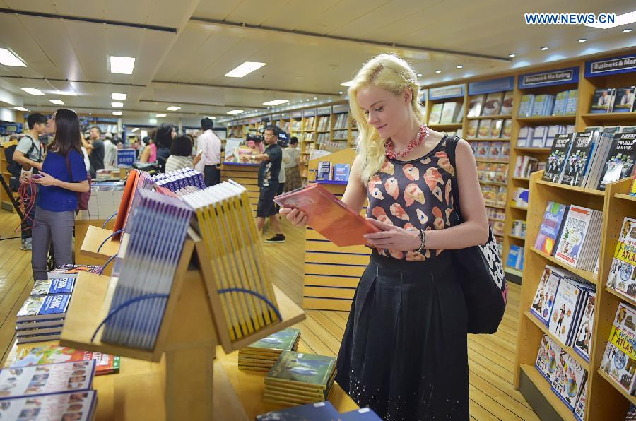 A visitor selects books at the book fair of Logos Hope in south China's Hong Kong, July 27, 2015.