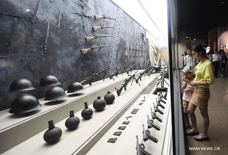 People visit the Taihang Memorial Hall of the Eighth Route Army in Wuxiang County, north China's Shanxi Province, July 29, 2015. The memorial hall was opened to the public in 1988 to depict the history of the Communist-led Eighth Route Army in the Chinese People's War of Resistance Against Japanese Aggressions from 1937 to 1945). (Xinhua/Yan Yan)