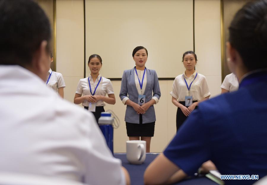 Candidates for flight attendant of China Southern Airlines wait to take part in the first round interview in Wuhan, capital of central China's Hubei Province, July 30, 2015. China Southern Airlines has extended the requirement of age for flight attendants to 30. (Xinhua/Cheng Min)