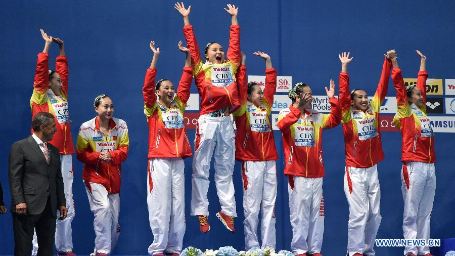 Team China celebrates on the podium during the awarding ceremony for team free of the synchonised swimming at the FINA World Championships in Kazan, Russia, July 30, 2015.
