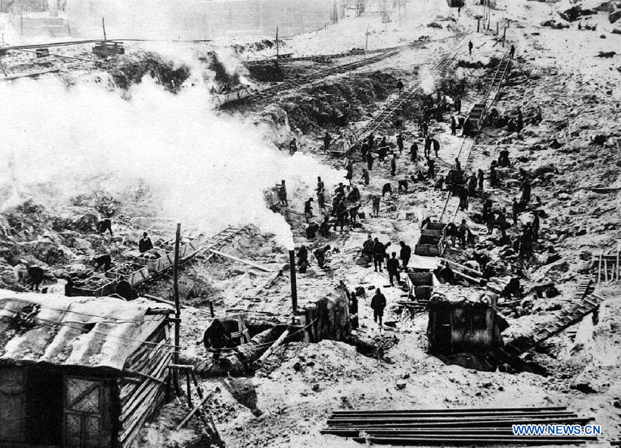 File photo copy shows Chinese forced labors working for Japan to build the Fengman hydropower station in Jilin of northeast China after the region was illegally occupied by Japanese invaders in 1931. Japan invaded northeast China in 1931 and conducted a full-scale invasion in 1937. By the end of World War II, millions of Chinese forced laborers had been enslaved by Japanese invaders to toil under harsh conditions at mines and factories in northeast China and Japan. Those laborers were under close watch and suffered inhumane treatment. Many of them died from malnutrition, illness, physical abuse and plain murder. (Xinhua/Jiang Lin)