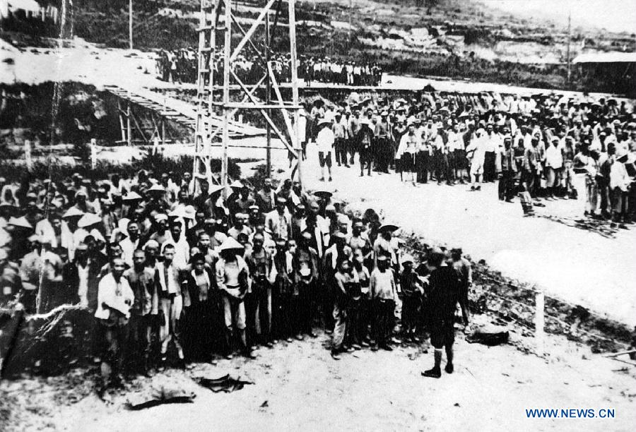 File photo copy shows the rollcall of Chinese forced labors working for Japan to build the Fengman hydropower station in Jilin of northeast China after the region was illegally occupied by Japanese invaders in 1931. Japan invaded northeast China in 1931 and conducted a full-scale invasion in 1937. By the end of World War II, millions of Chinese forced laborers had been enslaved by Japanese invaders to toil under harsh conditions at mines and factories in northeast China and Japan. Those laborers were under close watch and suffered inhumane treatment. Many of them died from malnutrition, illness, physical abuse and plain murder. (Xinhua)