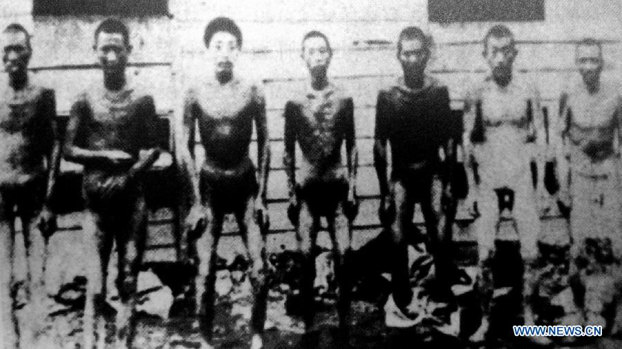 File photo copy shows Chinese forced labors in Hanaoka, Japan. Japan invaded northeast China in 1931 and conducted a full-scale invasion in 1937. By the end of World War II, millions of Chinese forced laborers had been enslaved by Japanese invaders to toil under harsh conditions at mines and factories in northeast China and Japan. Those laborers were under close watch and suffered inhumane treatment. Many of them died from malnutrition, illness, physical abuse and plain murder. (Xinhua)