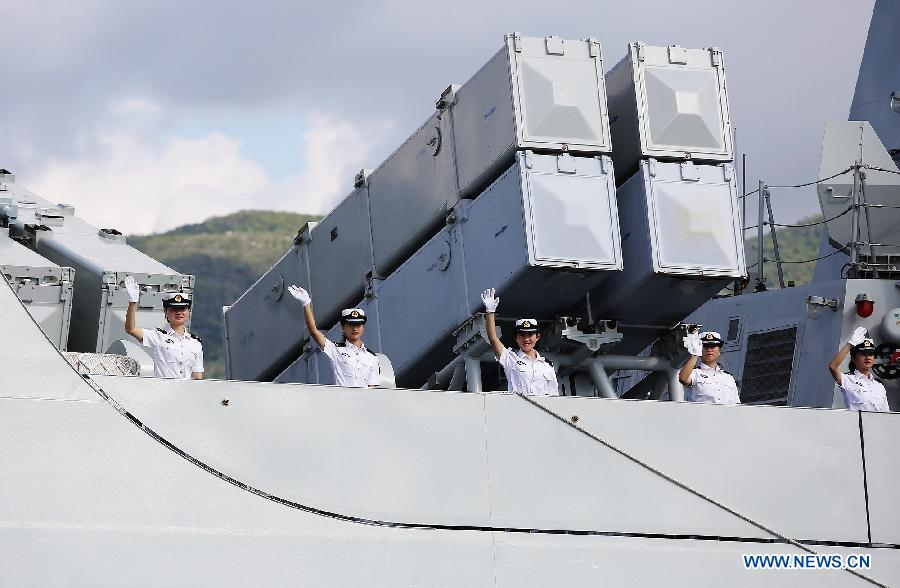 Female Chinese Navy soldiers wave to farewell at a naval port in Sanya, south China's Hainan Province, Agu. 4, 2015.