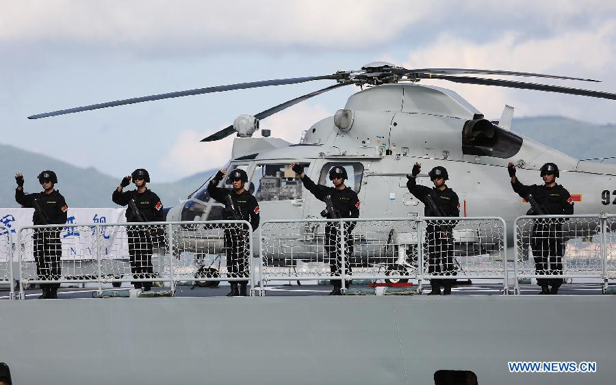 Chinese Navy soldiers wave to farewell at a naval port in Sanya, south China's Hainan Province, Agu. 4, 2015.