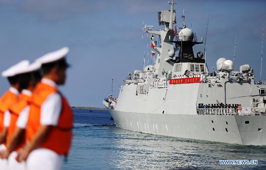 A Chinese Navy vessel prepare to sail at a naval port in Sanya, south China's Hainan Province, Agu. 4, 2015.