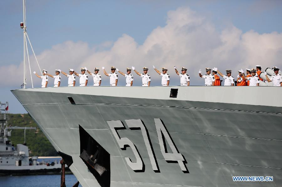 Chinese Navy soldiers wave farewell at a naval port in Sanya, south China's Hainan Province, Agu. 4, 2015.