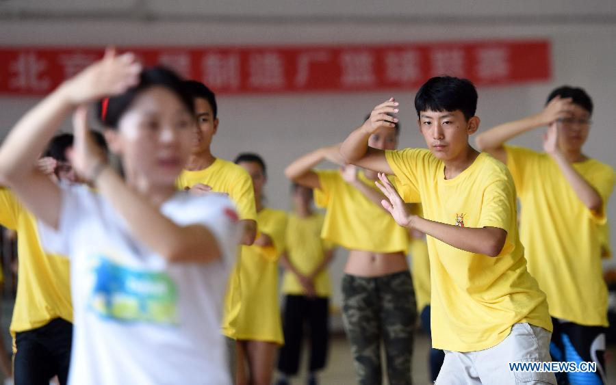 Overseas Chinese youth learn to perform Tai Chi during the 'Chinese Root-Seeking Tour' Summer Camp in Beijing, capital of China, Aug. 7, 2015.