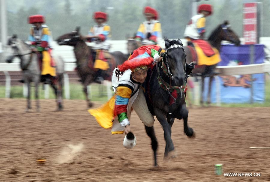 An athlete from southwest China's Tibet Autonomous Region performs horse racing during the 10th National Traditional Games of Ethnic Minorities of China in Ordos, north China's Inner Mongolia Autonomous Region, Aug. 10, 2015.