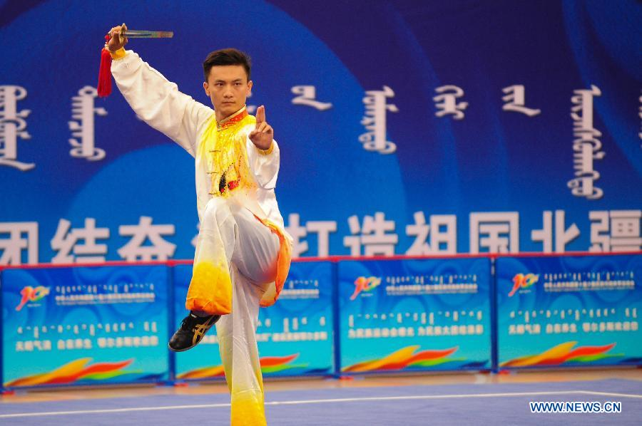 Wu Yanan from northwest China's Shaanxi Province competes in a men's game of martial arts of the ethnic minorities during the 10th National Traditional Games of Ethnic Minorities of China in Ordos, north China's Inner Mongolia Autonomous Region, Aug. 10, 2015.