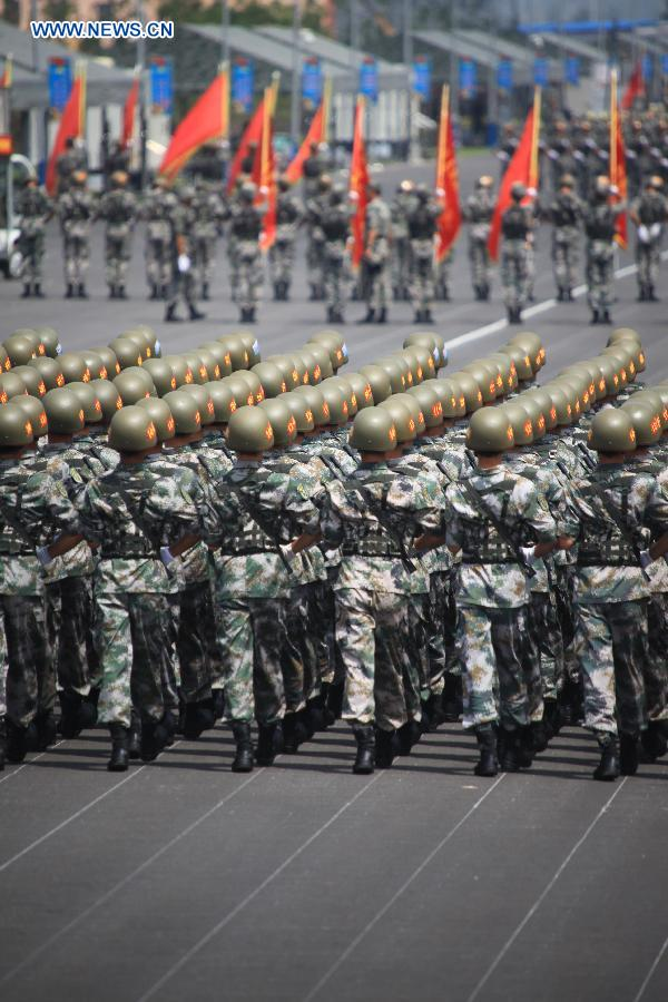 Photo taken on July 24, 2015 shows soldiers participating in training for the Sept. 3 military parade at the parade training base in Beijing.
