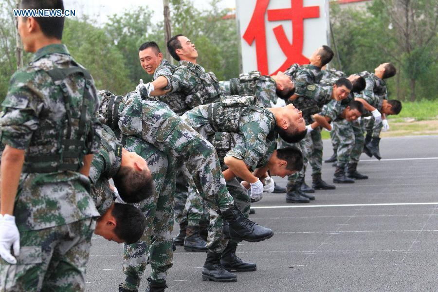 Photo taken on July 23, 2015 shows soldiers participating in training for the Sept. 3 military parade at the parade training base.