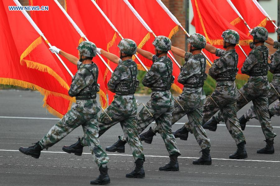 Photo taken on July 23, 2015 shows soldiers participating in training for the Sept. 3 military parade at the parade training base in Beijing.