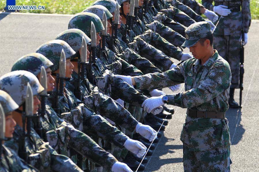 Photo taken on July 28, 2015 shows soldiers participating in training for the Sept. 3 military parade at the parade training base.