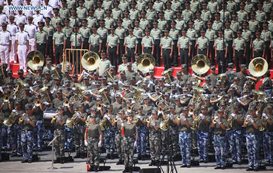 Photo taken on July 26, 2015 shows soldiers of the military band participating in training for the Sept. 3 military parade at the parade training base in Beijing.