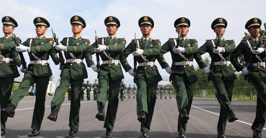 Photo taken on Aug. 14, 2015 shows soldiers participating in training for the Sept. 3 military parade at the parade training base in Beijing.