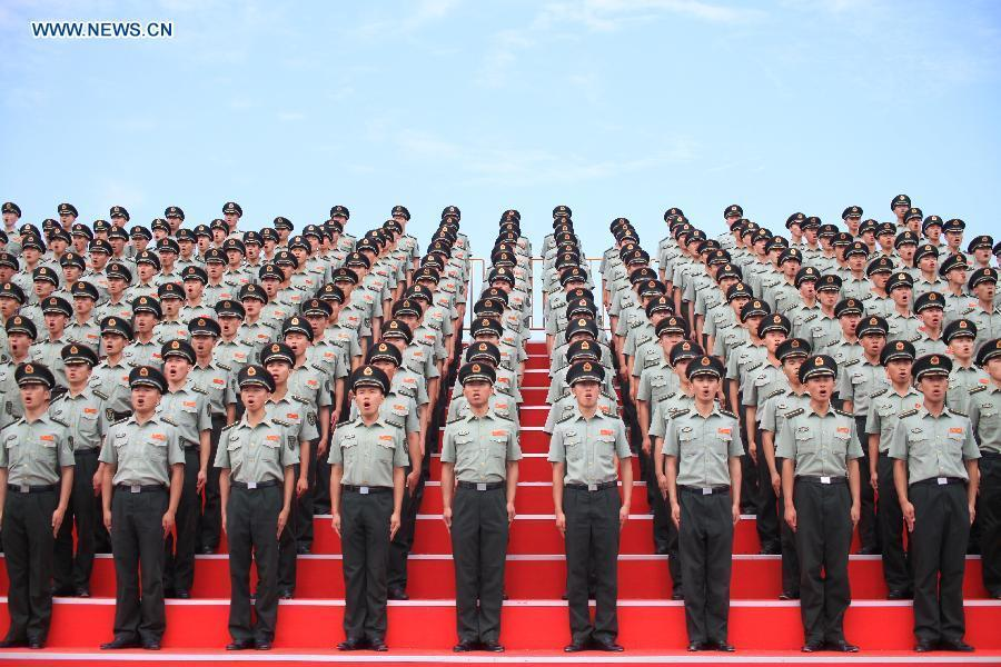 Photo taken on July 23, 2015 shows soldiers of the chorus participating in training for the Sept. 3 military parade at the parade training base in Beijing.