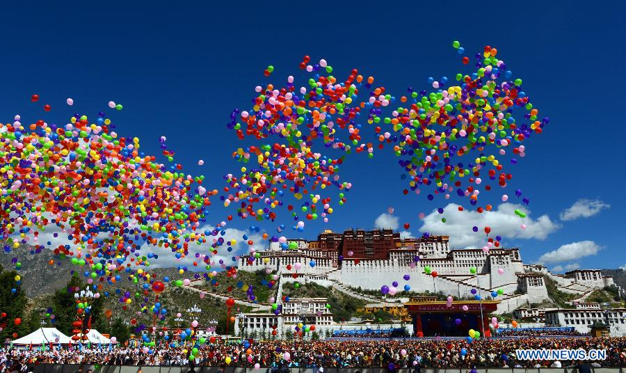 Colorful balloons fly into the sky at a grand ceremony marking the 50th anniversary of the founding of the Tibet Autonomous Region at the square of the Potala Palace in Lhasa, capital of southwest China's Tibet Autonomous Region, Sept. 8, 2015.