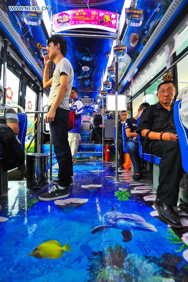 Passengers take an ocean theme bus in Changchun, northeast China's Jilin Province, Sept. 14, 2015.