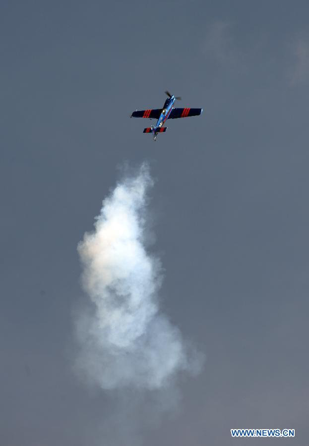 A plane performs during an air show at Andrews Air Base outside Washington D.C. in Maryland, the United States, Sept. 19, 2015.